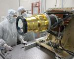 Lockheed Martin technicians prepare the GLM instrument