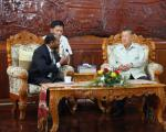 UN-SPIDER officer Shirish Ravan with the Minister of Agriculture of Lao PDR