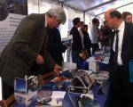 Minister Lersch-Mense of North Rhine Westphalia visiting the UN-SPIDER stand