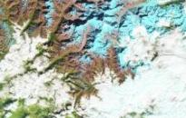 The false-color images above show a glacial lake in the Himalayas nearly doubling in length over 30 years. Ice is represented as light blue, while significant meltwater is dark blue. Rocks are brown; vegetation is green. The growth of glacial lakes can increase the risk of flooding in nearby valleys. Image: NASA.