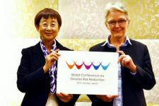 Mayor of Sendai City and UNISDR Chief present the Logo of the Conference