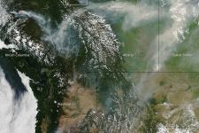 The image captured by MODIS shows dozens of wildfires in Canada