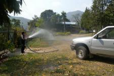 A firefighter demonstrates water hose in Makwanpur district (Image: ICIMOD)