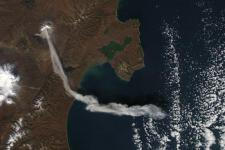 An image of the Sheveluch (Shiveluch) volcano in Kamchatka, Russian Federation emitting an ash plume taken by NASA's Aqua satellite in 2012. Image: NASA Earth Observatory.