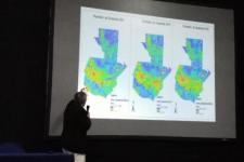 Member of Guatemalan team presenting drought maps.