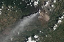 Similar eruption of the Mount Sinabung in Indonesia. Image courtesy of NASA Earth Observatory image by Jesse Allen and Robert Simmon, caption by Robert Simon.