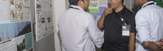 Participants discuss projects' outcomes presented in posters (Image: ICIMOD)
